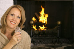 Gorgeous blonde in front of fireplace Stock Photo