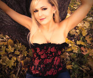 Gorgeous blonde girl in corset. Photo of beautiful blond girl Stock Images