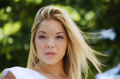 Gorgeous blonde girl headshot outdoors Stock Photography