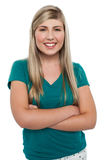 Gorgeous blonde girl posing arms crossed Royalty Free Stock Image