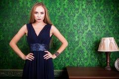Gorgeous blonde on green vintage background Stock Photo