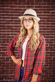 Gorgeous blonde hipster with hand on hips Stock Photography