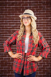Gorgeous blonde hipster posing with hands on hips Stock Photos