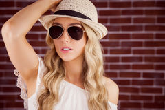 Gorgeous blonde hipster posing with straw hat Stock Photo