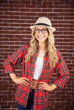 Gorgeous blonde hipster smiling with hands on hips Stock Photo