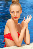 Gorgeous blonde lady in the pool Stock Image