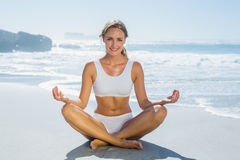 Gorgeous blonde in lotus pose by the sea Royalty Free Stock Photo