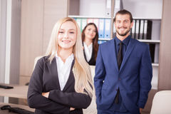 Gorgeous blonde manager in front of her team royalty free stock photography