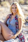 Gorgeous Blonde Model Posing Outdoors In The Desert Royalty Free Stock Images