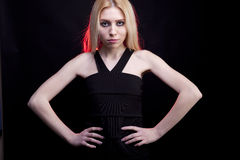 Gorgeous blonde model with a red light behind her Stock Photography