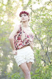 Gorgeous Blonde in Red Flower Crown Royalty Free Stock Images