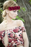 Gorgeous Blonde in Red Flower Crown Stock Images