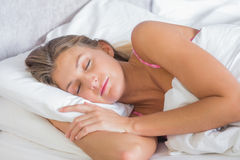 Gorgeous blonde sleeping peacefully in bed Royalty Free Stock Photo