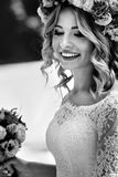 Gorgeous blonde smiling emotional bride in vintage white dress i Stock Photos