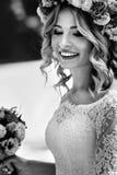 Gorgeous blonde smiling emotional bride in vintage white dress i Stock Photos