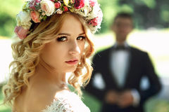 Gorgeous blonde smiling emotional bride in vintage white dress i Stock Photography
