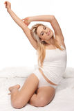 Gorgeous blonde stretching as she wakes up Stock Images