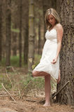 Gorgeous blonde teen girl in forest Royalty Free Stock Photography