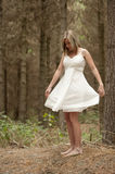 Gorgeous blonde teen girl in forest Stock Images