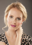 Gorgeous blonde woman in animal print shirt Royalty Free Stock Images
