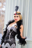 Gorgeous Blonde Woman Flapper. Beautiful blonde in 1920s era of fashion The Flapper