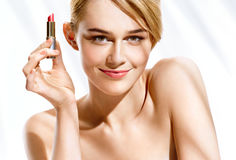 Gorgeous blonde woman with lipstick on white background Stock Photography