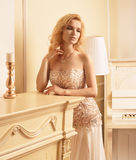 Gorgeous blonde woman in luxury interior Stock Photo
