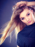 Gorgeous blonde woman with open waving hair. Royalty Free Stock Images