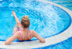 Gorgeous blonde woman in a pink bikini in the water Stock Images
