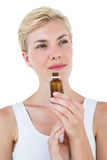 Gorgeous blonde woman smelling bottle of medicine Stock Photos