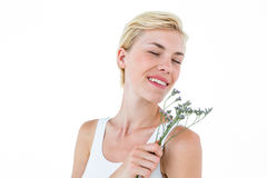 Gorgeous blonde woman smelling flowers Royalty Free Stock Photos