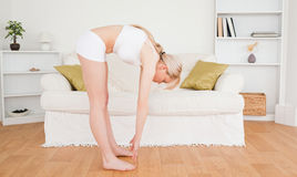 Gorgeous blonde woman stretching Stock Photos