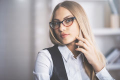Gorgeous blonde woman talking on phone Stock Photography