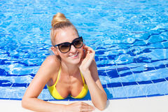 Gorgeous blonde woman in a yellow bikini in the water Royalty Free Stock Image