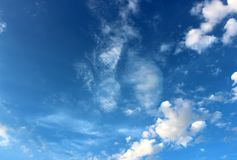 Gorgeous blue skies with puffy clouds moving with the cool Summer wind. Conceptual image of cobalt blue sky with puffy clouds moving across the face of it under stock images