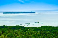 Romantic view of beautiful blue water Indian ocean on the horizon. Gorgeous blue sky above a sea water Indian ocean with view from top of the hill during summer royalty free stock photo