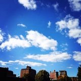 Gorgeous blue sky's. Clouds blue sky's buildings Royalty Free Stock Photos