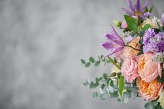Gorgeous bouquet of different flowers. floral arrangement in vintage metal vase. table setting. lilac and peach color.  royalty free stock images