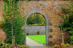 Gorgeous brick and stone archways through garden Royalty Free Stock Photos