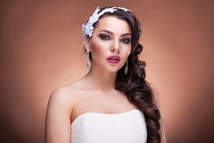 Gorgeous bride with amazing hairstyle in studio photo Royalty Free Stock Photography