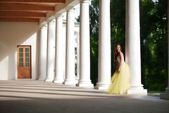 Gorgeous bride amongst colonnades Stock Photography