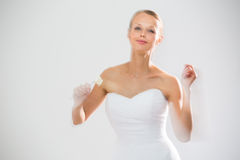 Gorgeous bride dancing, holding a rose Stock Photo