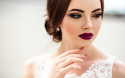 Gorgeous bride with fashion makeup and hairstyle in a luxury wedding dress. Beauty portrait Stock Images