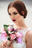 Gorgeous bride with fashion makeup and hairstyle in a luxury wedding dress stock photography