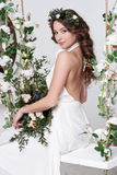 Gorgeous bride with flowers Royalty Free Stock Images