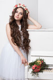 Gorgeous bride with flowers over white background Royalty Free Stock Image