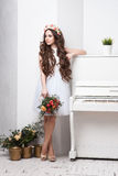 Gorgeous bride with flowers over white background Royalty Free Stock Photos