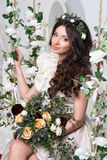Gorgeous bride with flowers Royalty Free Stock Photo