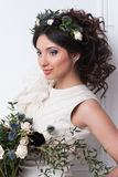 Gorgeous bride with flowers. Royalty Free Stock Images