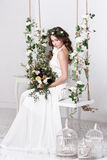 Gorgeous bride with flowers. Wedding Royalty Free Stock Photos